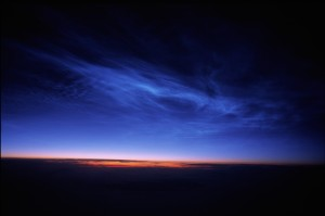 Noctilucent clouds. Image via NASA